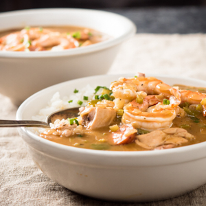 gumbo in a bowl with spoon from the front