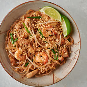 Easy pad Thai in a bowl with lime garnish