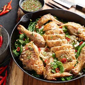 Thai roast chicken in a cast iron pan