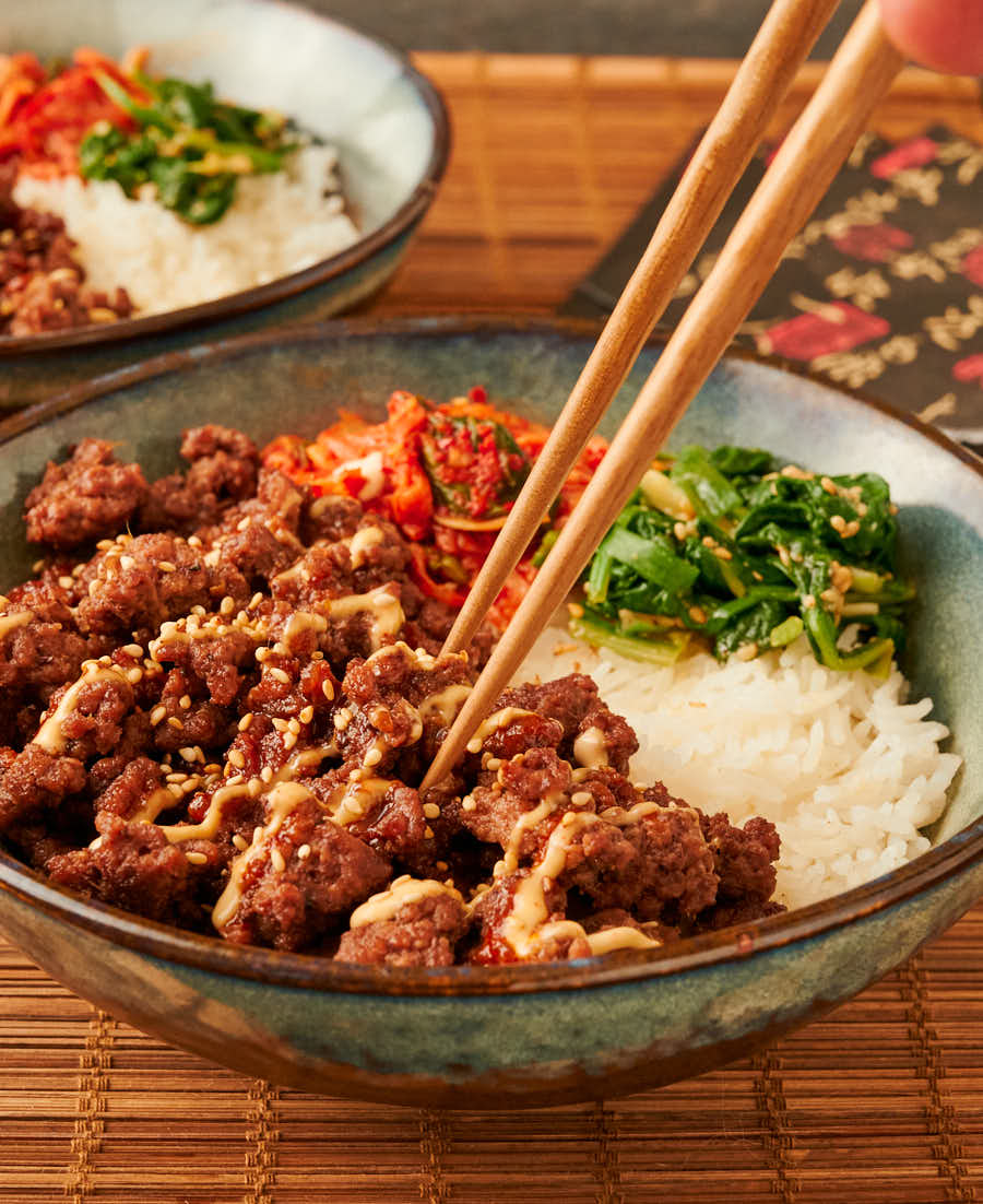 Korean beef bowl with chopsticks from the front.