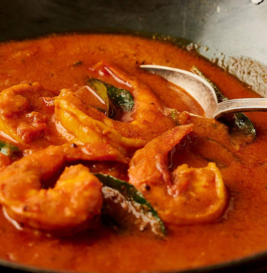 Close-up of prawns in a lush gravy from the front.