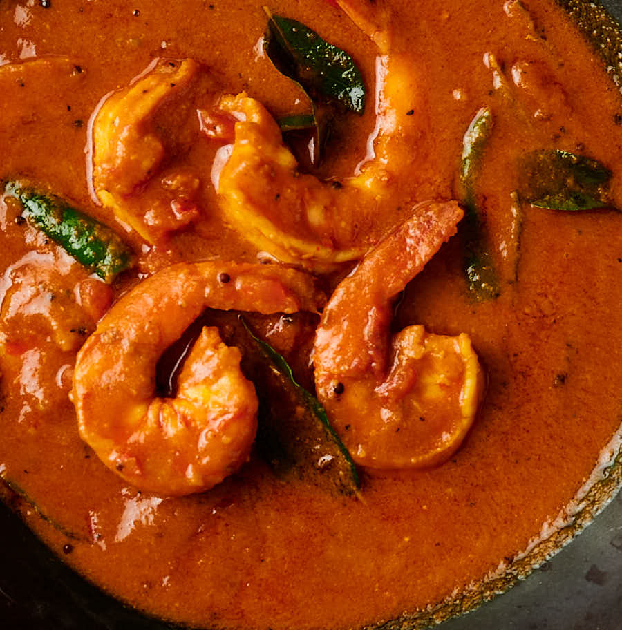Close-up of shrimp in rich South Indian gravy
